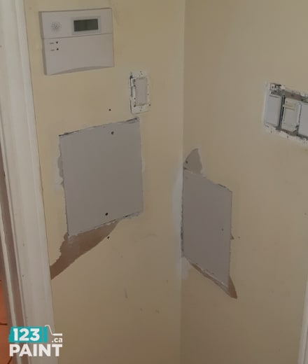 Drywall patch installed in wall for repair job
